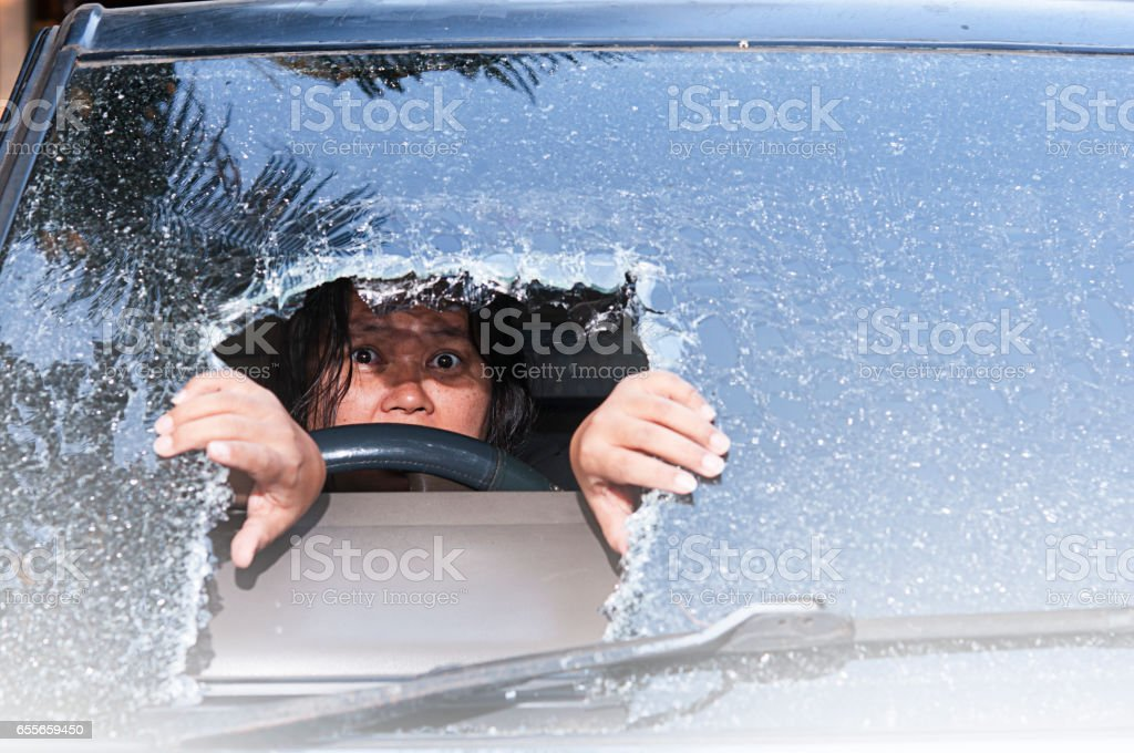 girl in car at the windshield face crack. – zdjęcie