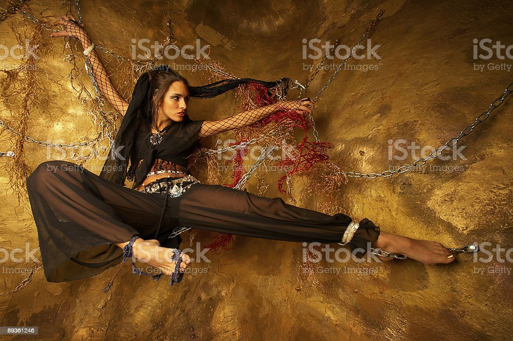 Girl in chains royalty free stockfoto
