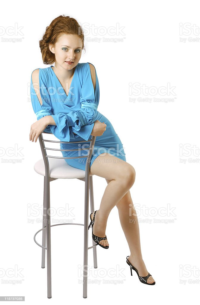 Girl in coctail dress on high chairs stock photo