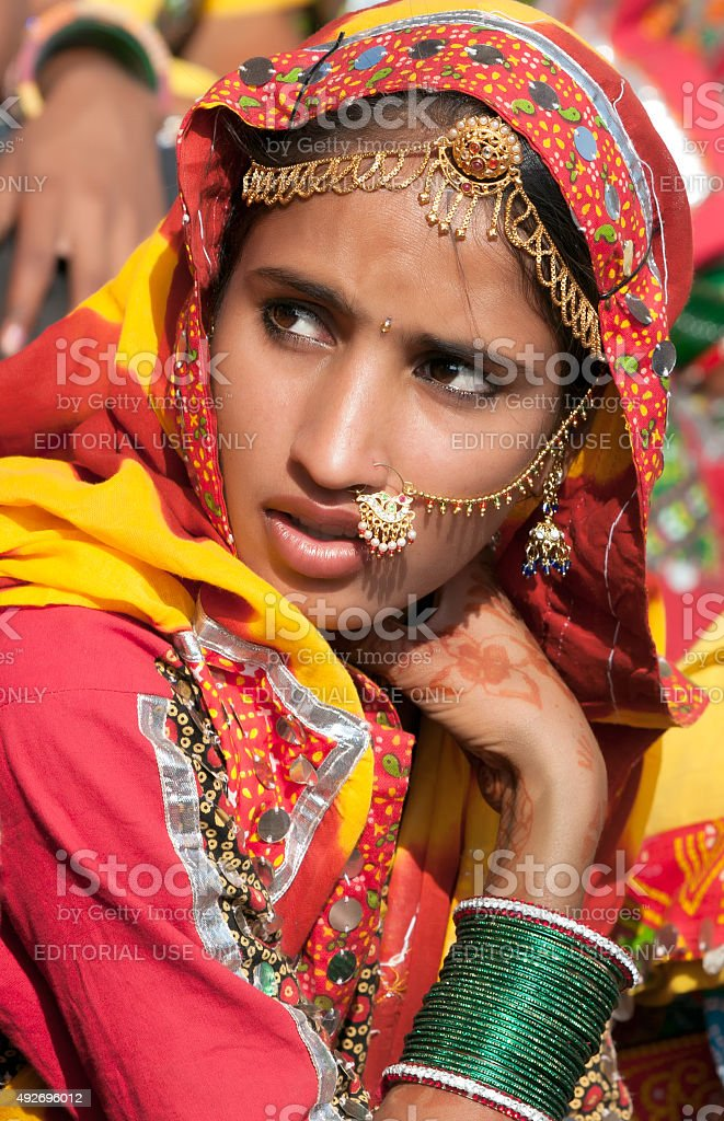 Girl in colorful ethnic attire attends at the Pushkar fair stock photo