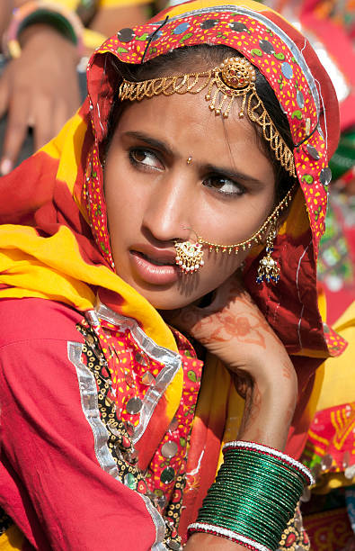 Girl in colorful ethnic attire attends at the Pushkar fair stock photo