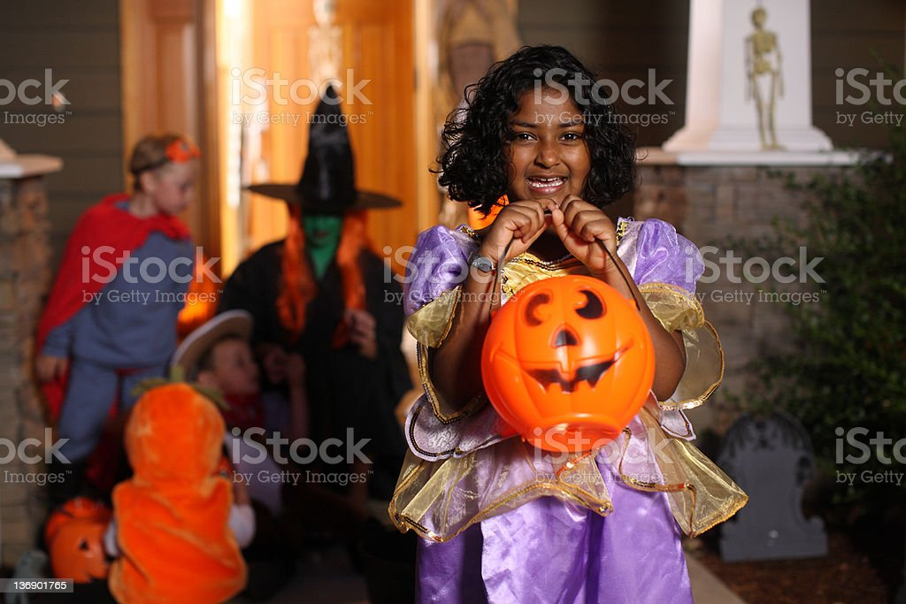 Girl in costume at Halloween party stock photo