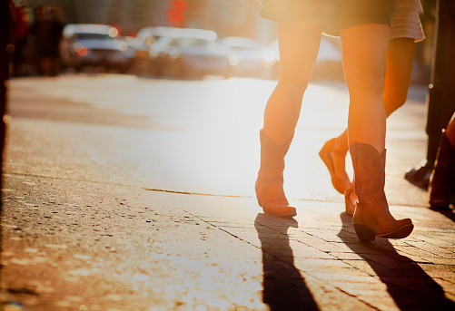 Girl In Cowboy Boots Walking On Lower Broadway Street Nashville Stock Photo - Download Image Now
