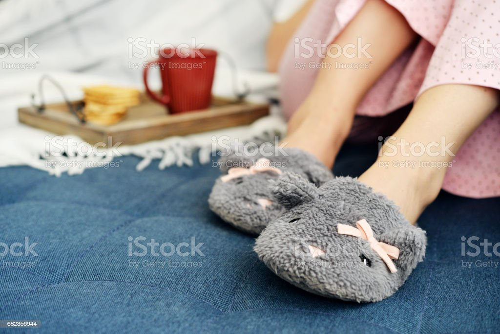 Girl in cute slippers royalty free stockfoto