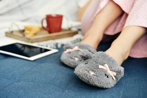 Girl in cute slippers stock photo