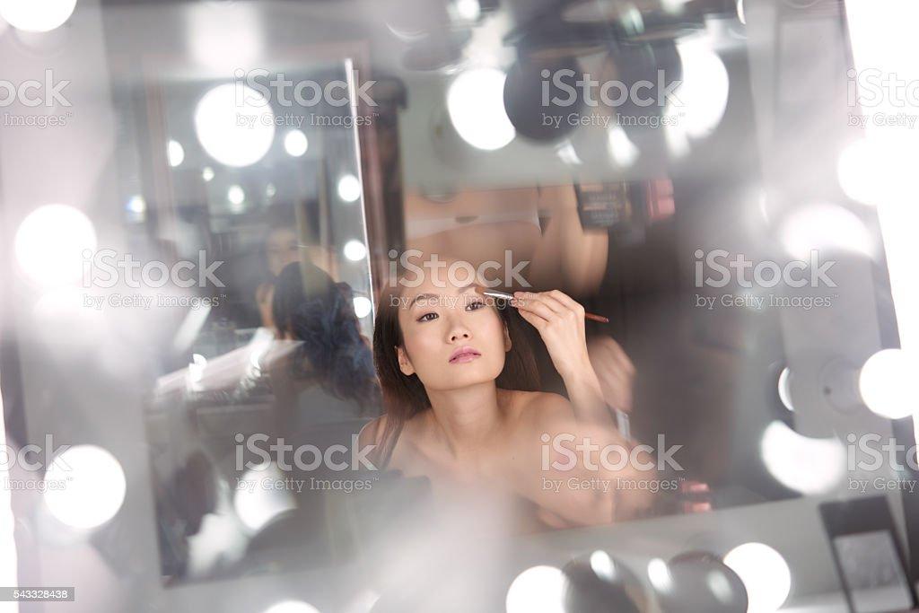 Girl in dressing room stock photo