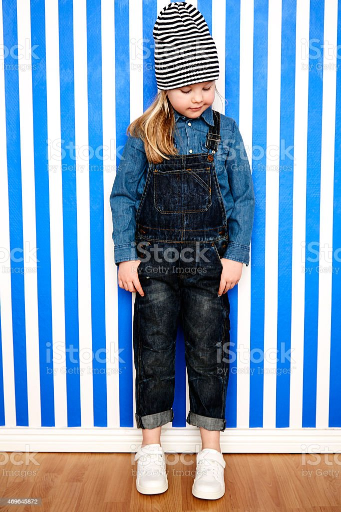 Girl in dungarees stock photo