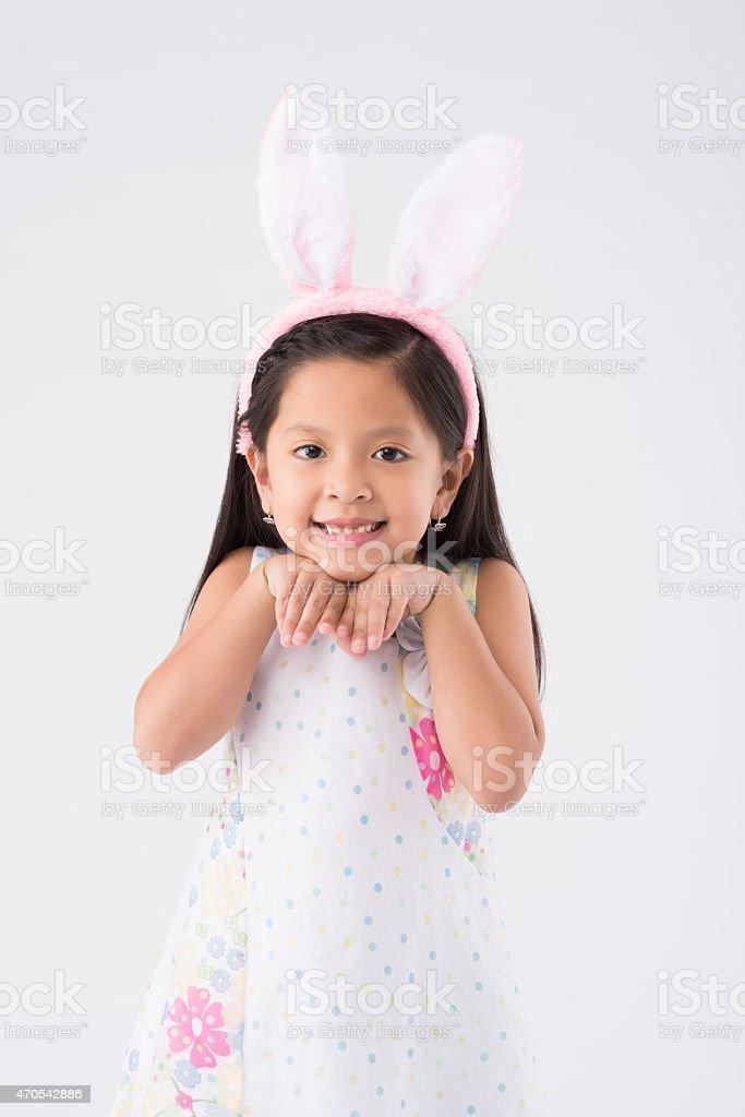 Girl in Easter bunny ears stock photo