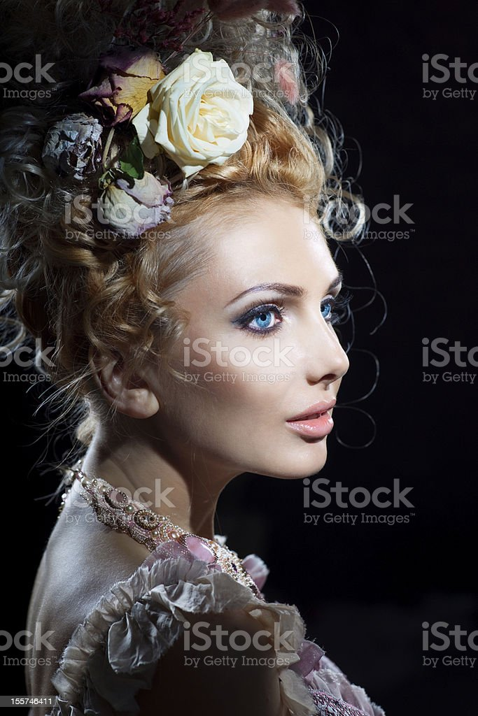 Girl in flowers stock photo