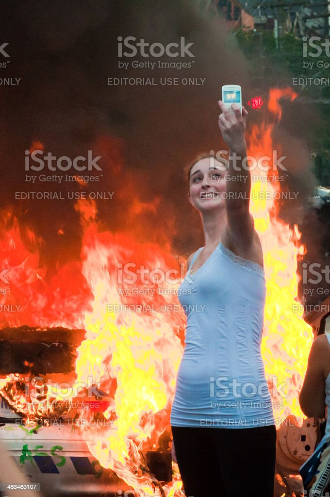 Girl in front of a fire stock photo