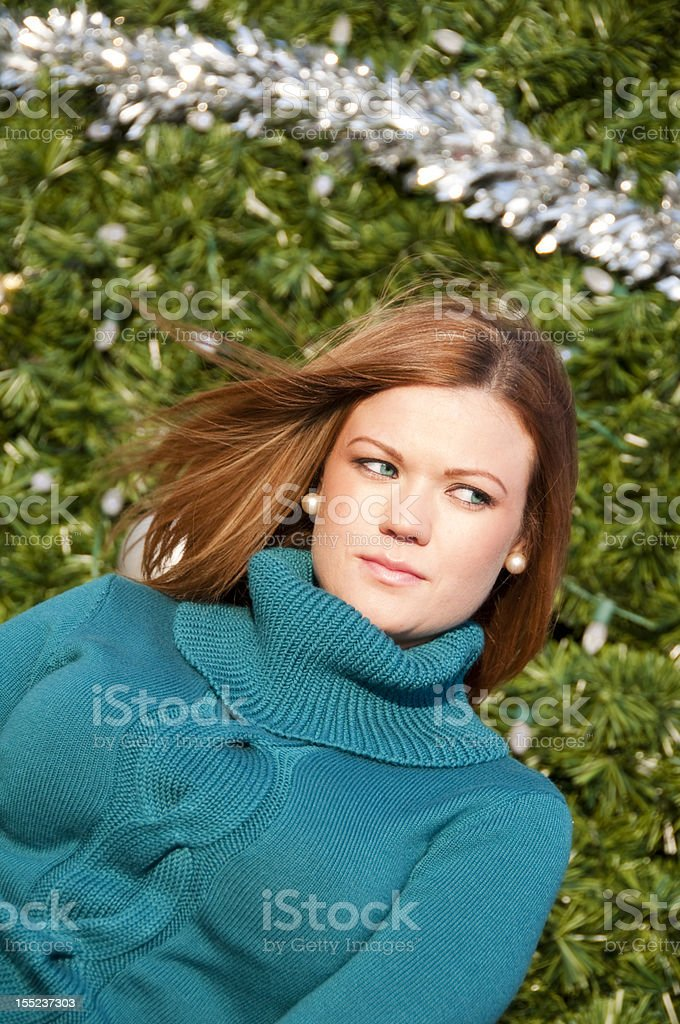 Girl in Front of Christmas Tree stock photo