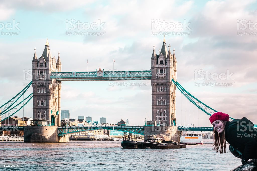 Girl in front of London Tower Bridge stock photo