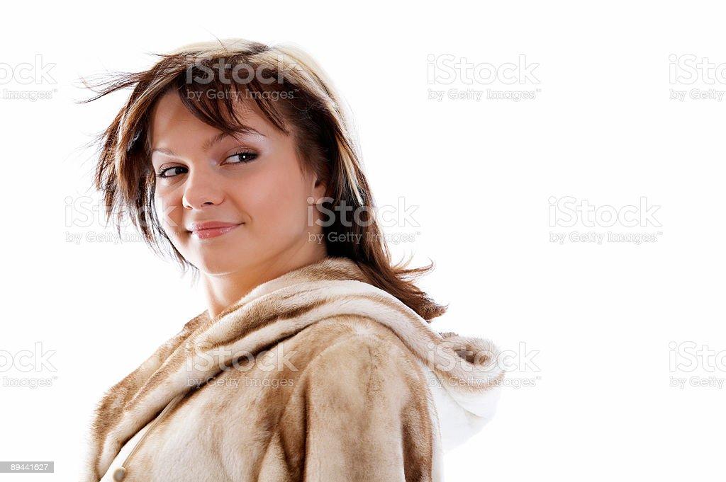 Girl in fur coat on white background royalty free stockfoto