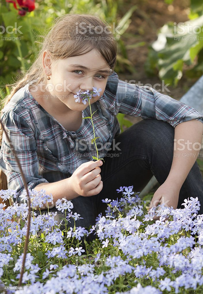 Girl in garden royalty-free stock photo