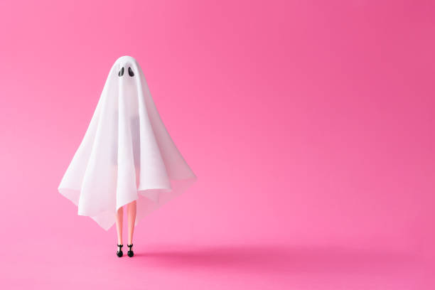 Girl in ghost costume against pastel pink background picture id1036611466?b=1&k=6&m=1036611466&s=612x612&w=0&h=icux2gtht5qbndgy  vuggbvck j93ivywa3c2yaii0=