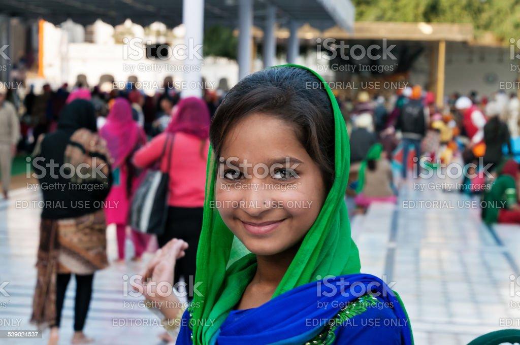 Girl in Golden Temple. Amritsar. India stock photo