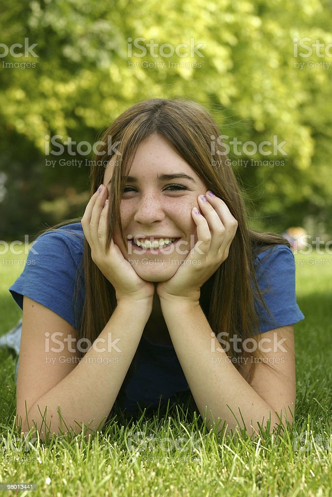 Girl  in grass royalty free stockfoto