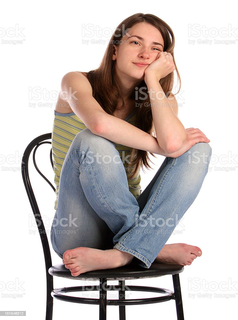 Girl in green stripy top sit on stool dreaming. royalty-free stock photo