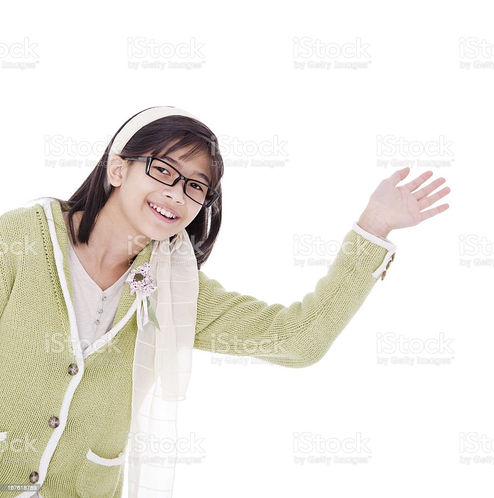 Girl in green sweater waving a warm welcome, isolated royalty-free stock photo