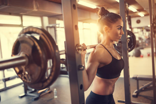 Girl in gym, back view stock photo