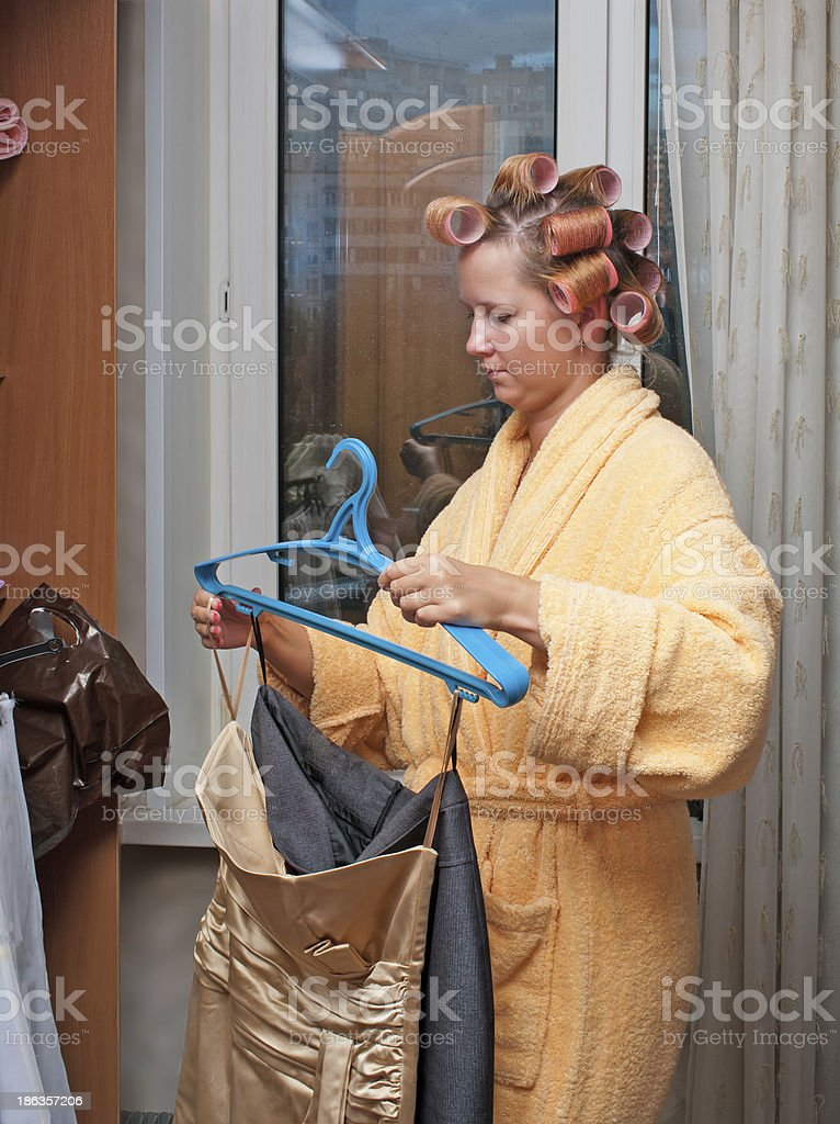 Girl in hair curlers. royalty-free stock photo