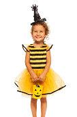 istock Girl in Halloween bee stripped costume 513254827