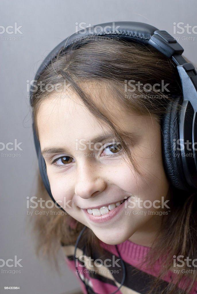 Girl in headphones enjoying music royalty-free stock photo