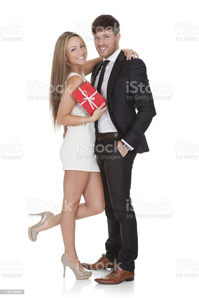 Girl in high shoes holds gift royalty-free stock photo