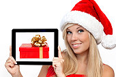 girl in holding tablet with the gift box