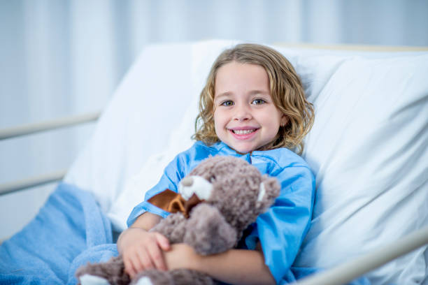 Girl In Hospital Bed stock photo
