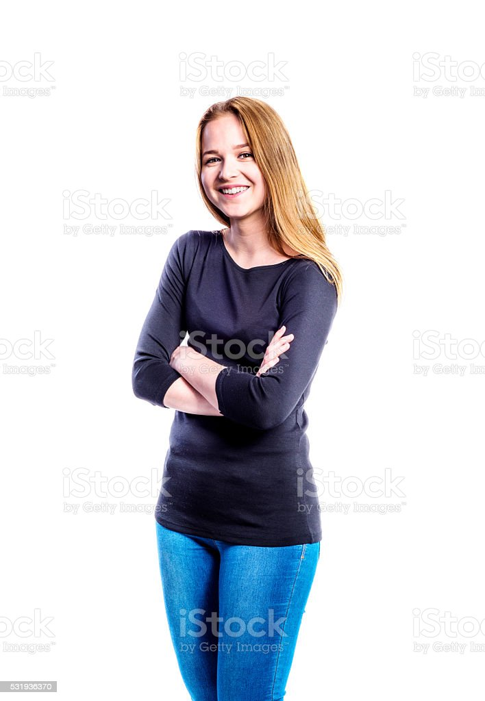 Girl in jeans and t-shirt, young woman, studio shot stock photo