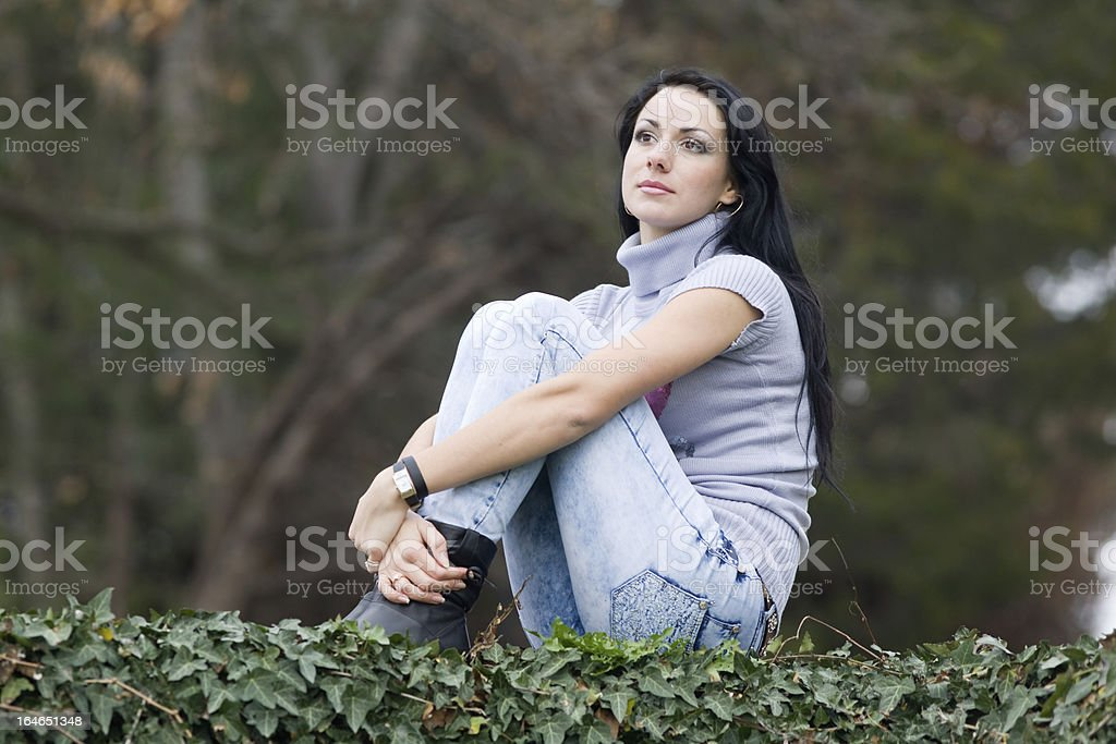 Girl in jeans at the park royalty-free stock photo