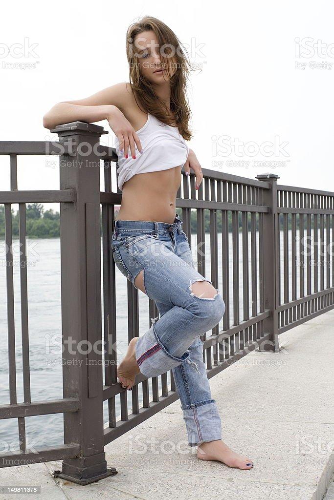 girl in jeans stock photo