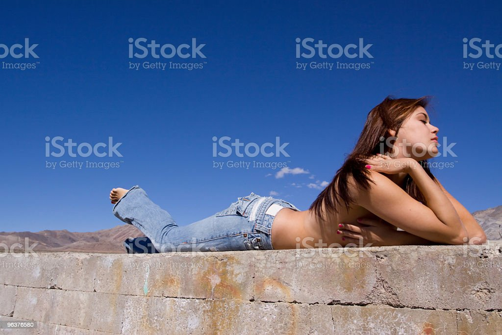 Girl in jeans relaxing royalty-free stock photo