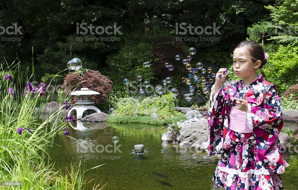 girl in kimono with soap bubbles royalty-free stock photo
