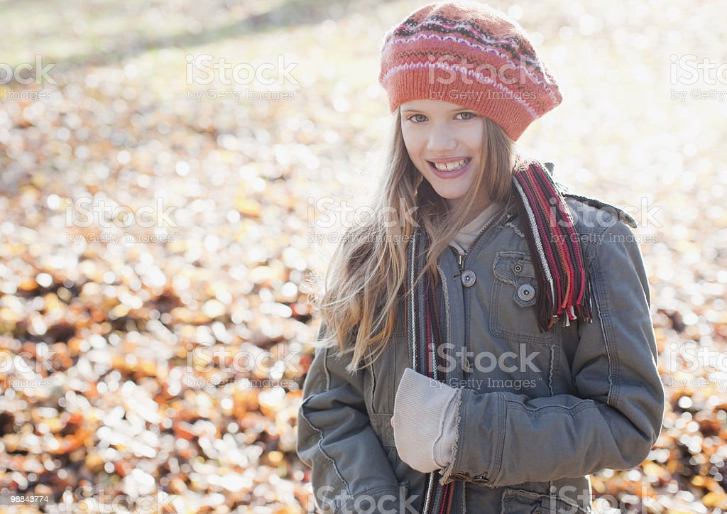 Girl in knit cap outdoors in autumn 免版稅 stock photo