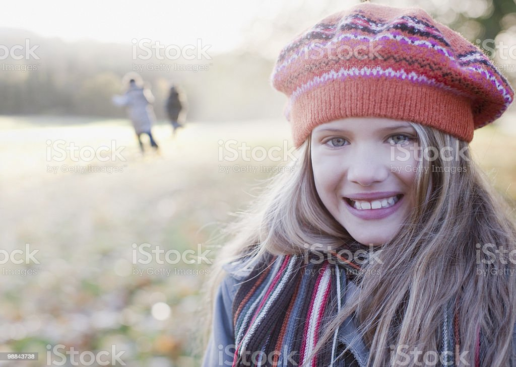Girl in knit cap smiling outdoors in autumn 免版稅 stock photo