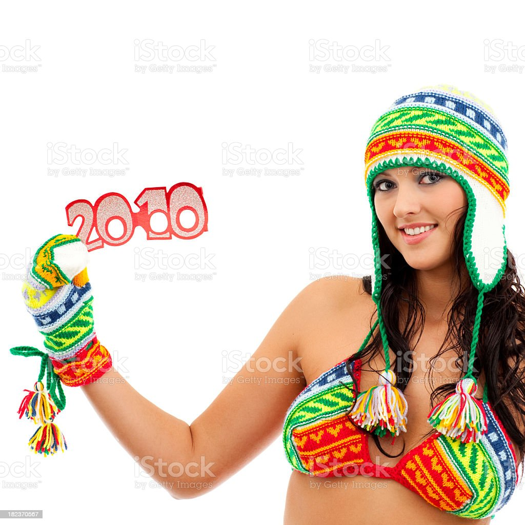 Girl in knitted costume showing 2010 stock photo