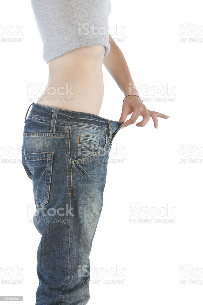Girl in large jeans royalty-free stock photo