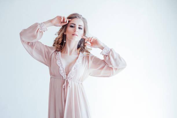 Girl in lingerie pajamas pink in a white room picture id1221239781?b=1&k=6&m=1221239781&s=612x612&w=0&h=euzj9hr9ykx vlisnufae5bx34ko4notm za5yi dbm=
