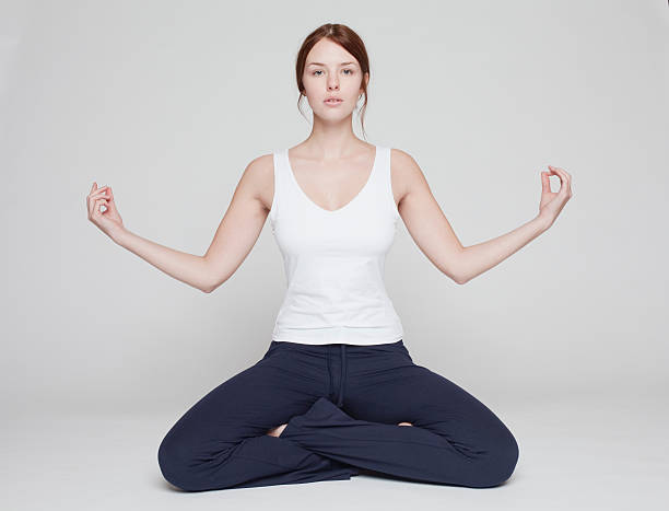 girl in lotus position on white background  lotus position stock pictures, royalty-free photos & images