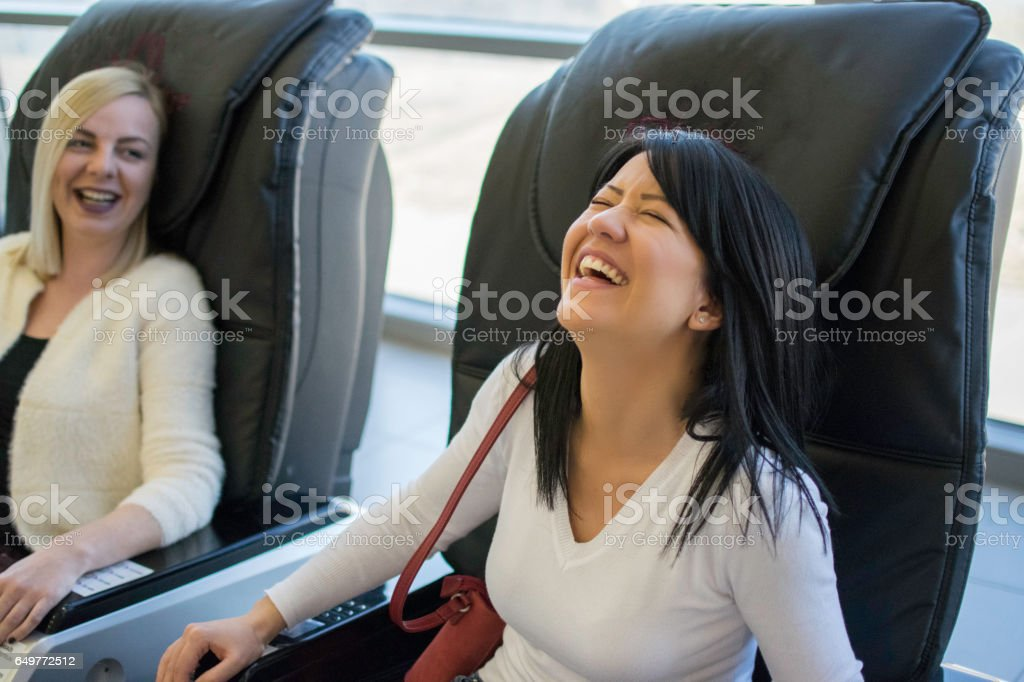 Girl in massage chair stock photo