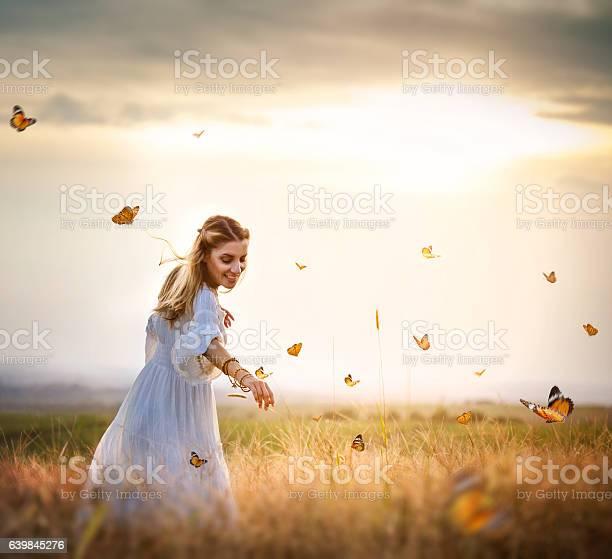 Girl in meadow with flitting butterflies picture id639845276?b=1&k=6&m=639845276&s=612x612&h=vkhvul8m8elcssbo6w6cgvvot7sxu3nsrpose2gf0lq=
