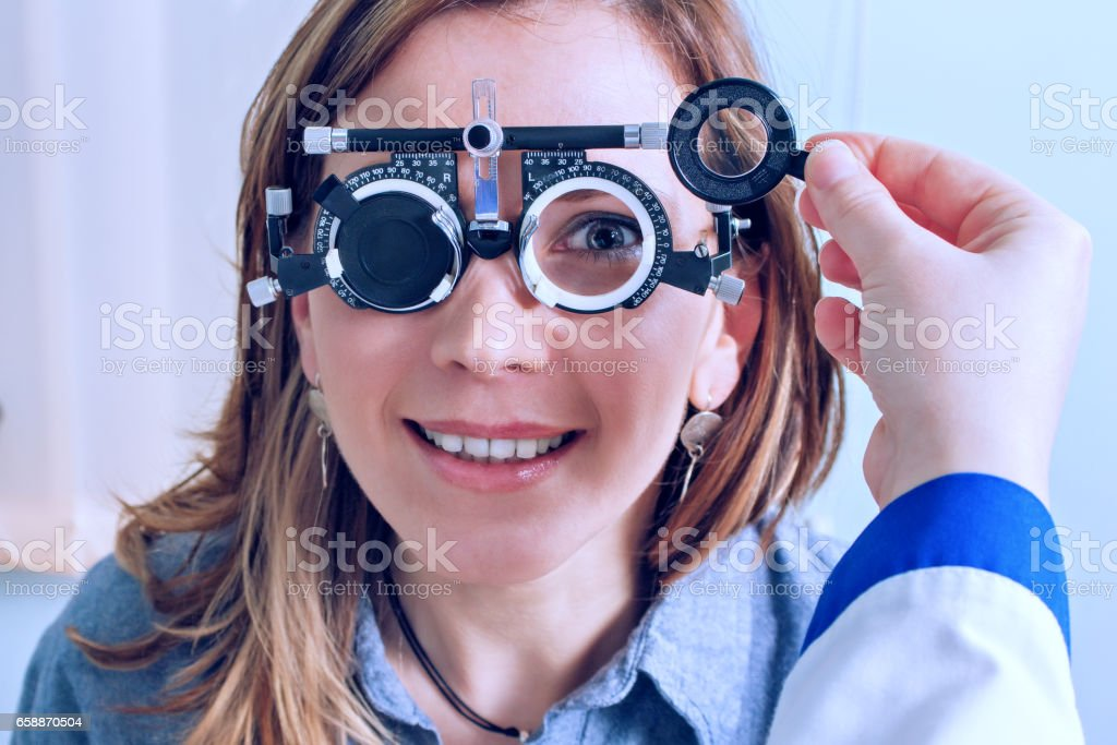 Girl in messbrille glasses in ophthalmology clinic stock photo