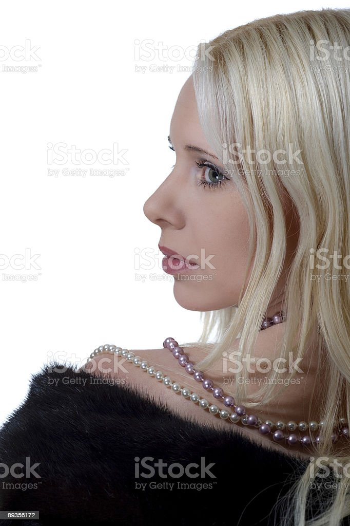 Girl in mink coat royalty free stockfoto