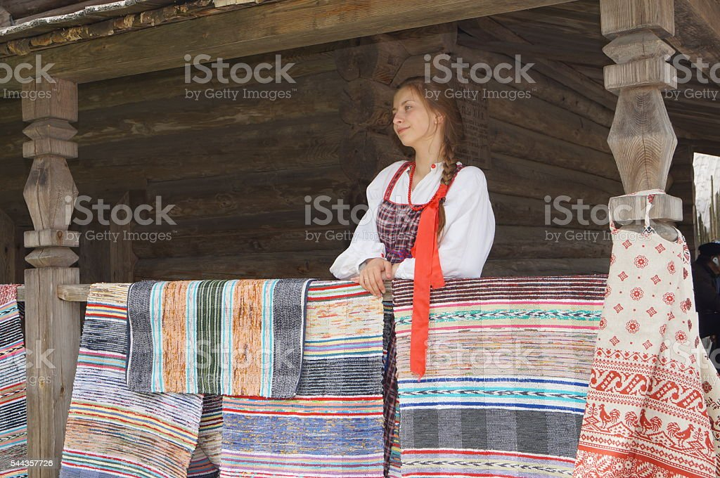 girl in national dress stands on the porch of an stock photo