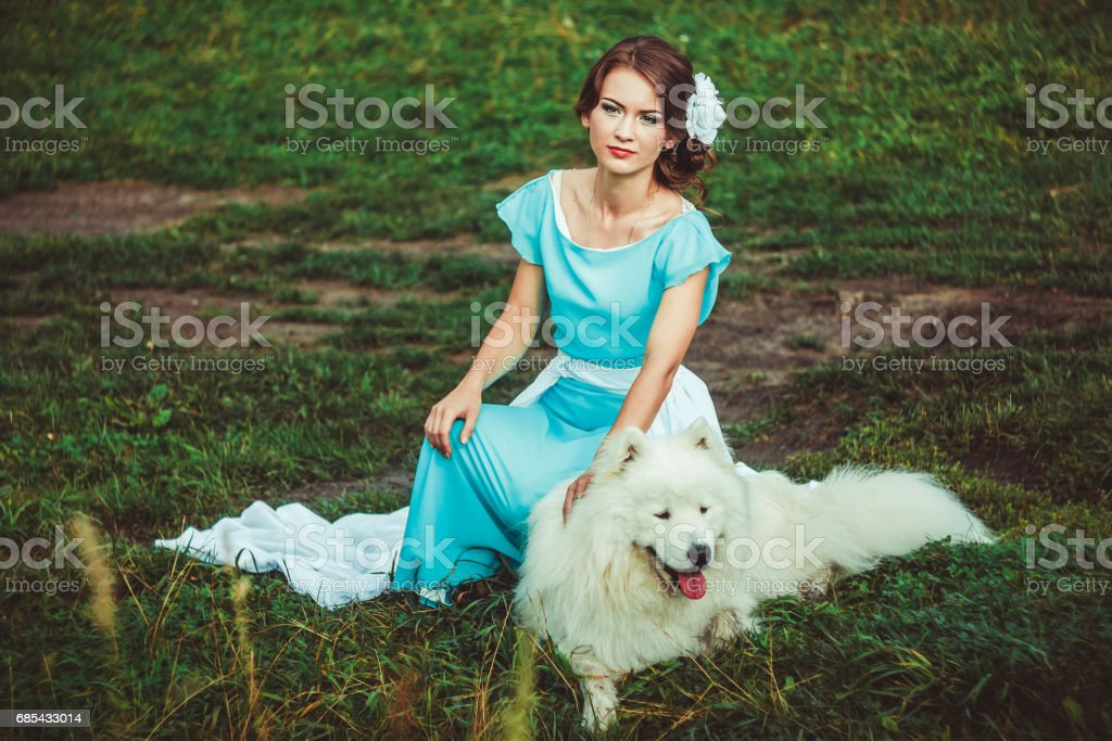 Girl in nature with a dog foto de stock royalty-free