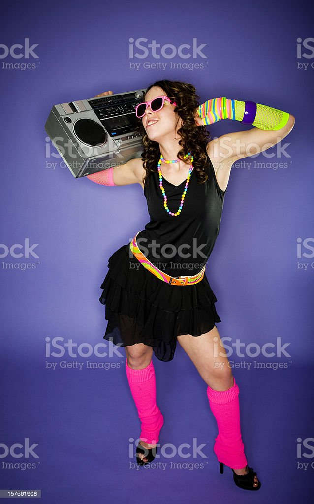 Girl in neon clothes with boom box royalty-free stock photo