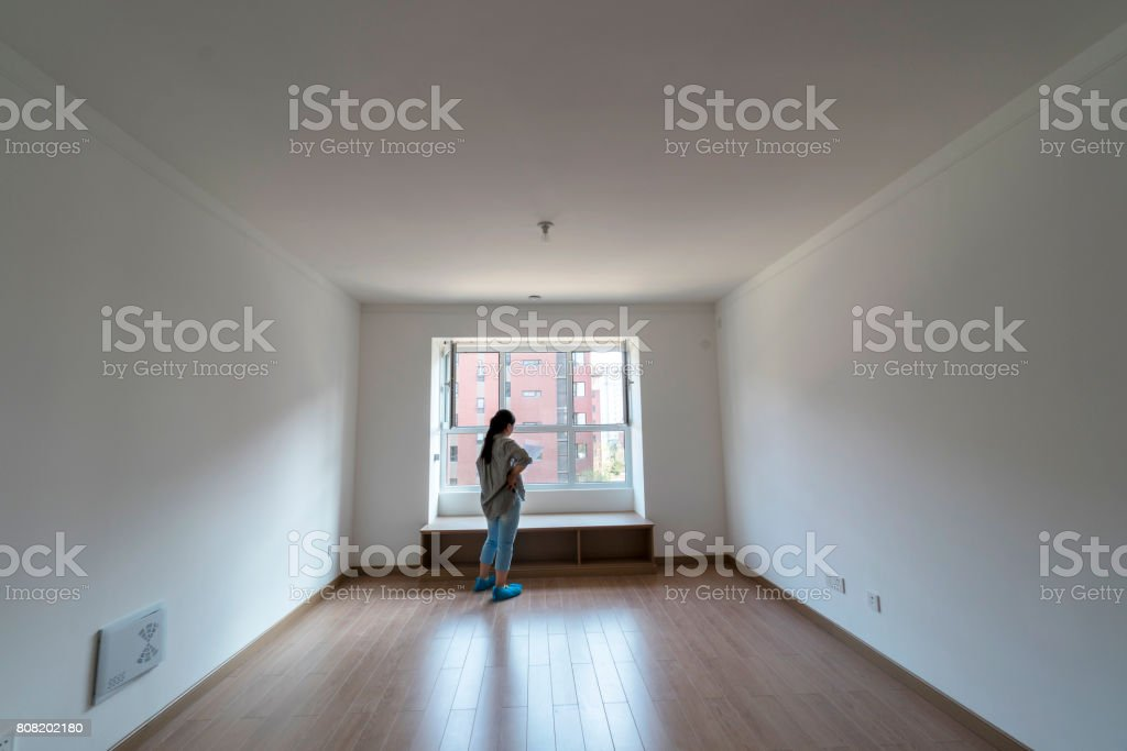 girl in new house, planning house decoration stock photo