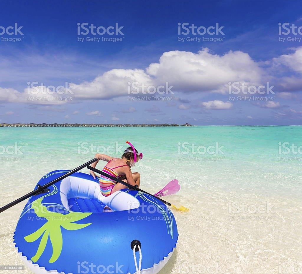 Girl in ocean stock photo